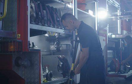 fireman maintaining fire equipment